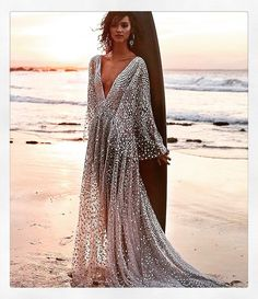 Still lustering for the summer again. I can almost feel the sun in this picture bouncing off the jewels in this dress! #beachwedding #beachweddingdress