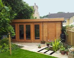 This versatile log cabin incorporates a garden room with an integral store - neat heh? Summer House Garden, Home And Garden, Wooden Summer House, Summer Houses, Garden Modern, Garden Office Shed, Somerset Garden, Garden Log Cabins, Narrow Garden
