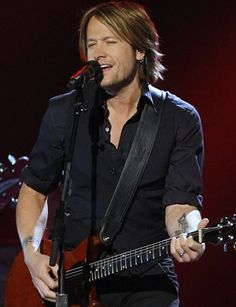 Keith Urban, keeps me watching American Idol...This man has a smile that just makes me smile right back!
