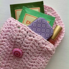 Small crochet purse-crochet rectangle, fold in half and stitch up on one side crochet the flap and add a button. make button hole or chain a loop