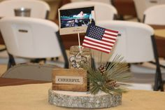 Eagle Scout Court of Honor centerpiece. Each of the 12 tables had a block with a word from the Scout Law and a picture from one of the 12 years of Scouting he did. Tiger - Eagle It was set on a 3' square of burlap that was laid over dark brown tablecloth.