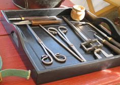 18th century surgeon's tools. The little jar at the top right holds a collection of musket balls removed from patients. (From Yorktown Victory Center.)