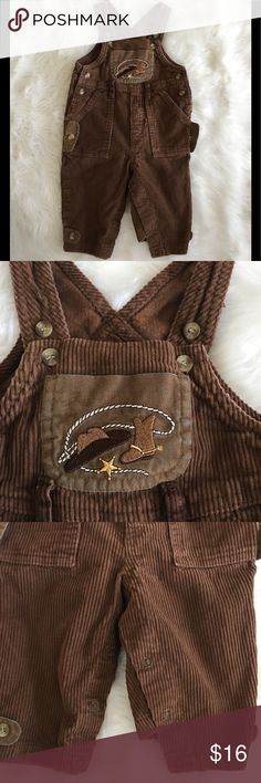 Cowboy Boots Hat Western Brown Corduroy Overalls Greendog Cowboy Boots Hat Western Brown Corduroy Overalls Baby Size 12 Months  100% Cotton  Snaps for easy diaper changes- snaps are incorrectly snapped in picture.  Embroidered cowboy boots & hat pocket on front.  Size 12 MONTHS  As previously mentioned, excellent condition with some light washwear.  Quick shipping! WE SHIP EITHER THE SAME BUSINESS DAY OR NEXT. ORDERS ON WEEKENDS ARE IN MAIL BY MONDAY MORNING. Greendog Bottoms Overalls