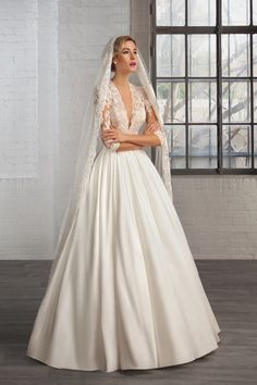 Th elegant new wedding dress collection from Cosmobella features stunning   illusuion lace details and romantic tulle.