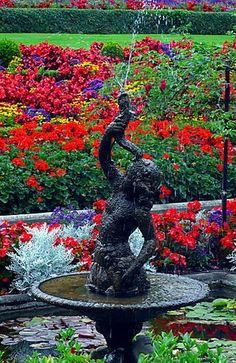 A riot of color in this Italian garden design...    www.facebook.com/loveswish