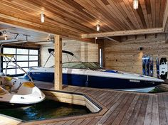 This boathouse design was completed by Altius Architecture, on the shore of Lake Joseph, in the cottage country town of Parry Sound, Ontario, Canada. Garage Bateau, Boat Garage, Lake Dock, Boat Dock, Haus Am See, Lakefront Property, Floating House, Wooden House, Rustic Design