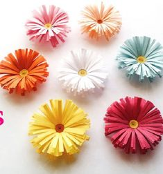 With this nice video (quilling) craft tutorial you can learn how to make these cute paper spring flowers / daisies! These colorful paper flowers are perfect spring decors for your home, and believe or not it's a very easy craft project! Paper Flowers For Kids, Paper Flower Garlands, Giant Paper Flowers, Paper Crafts For Kids, Diy Easy Paper Flowers, Paper Flower Bouquets, How To Make Flowers Out Of Paper, Making Tissue Paper Flowers, Free Paper Flower Templates