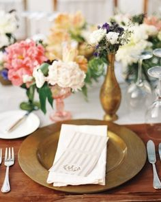 White cotton runners and gilded wood plates create a tropical yet elegant look for this Bali wedding