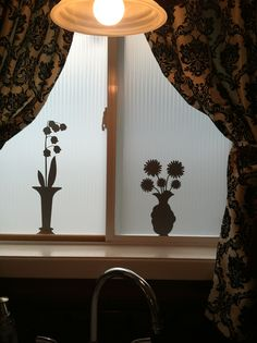 I put a privacy window cling to cover my window then used grey wall stickers on top to create a shadow effect.