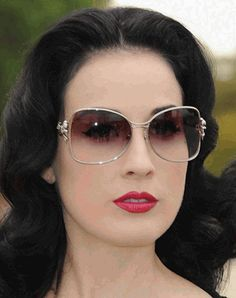 burlesque model, Dita Von Teese   She is gorgeous. Love the sunglasses