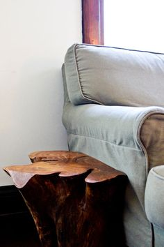 Tree stump side table, Kathryn Bentley's California craftsman house tour, via Apartment Therapy.