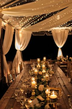 A combination of fabric and twinkle lights make for a beautiful layered look in a wedding tent!