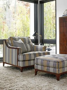 From the gold and gray color scheme to the bold pinstripes, this oversized chair and ottoman are our new traditional living room dream!