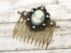 Cameo hair comb in blue bronze with girl antique by Schmucktruhe
