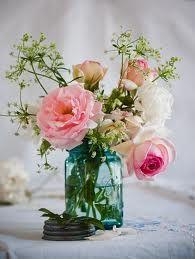 Perfect little wedding centerpieces~Love the blue ball glass mason jars