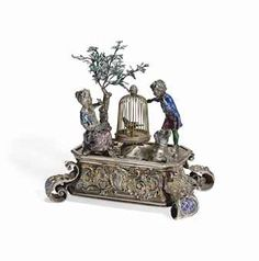 A CONTINENTAL SILVER AND ENAMEL SINGING BIRD AUTOMATON MARKED WITH AN AUSTRO-HUNGARIAN IMPORT MARK, LATE 19TH/EARLY 20TH CENTURY