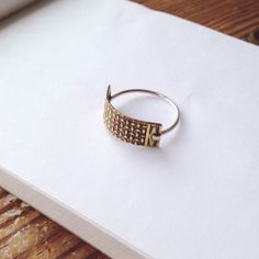 Diamond stamped brass with riveted sterling silver band.