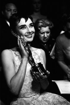 Audrey Hepburn cradles the award she won for Roman Holiday.