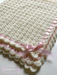 The Pemberley Heirloom baby blanket crochet pattern is so dainty and elegant. It's delicate stitch pattern and scallop edge are the perfect combination. Add a pretty ribbon and tie a bow to complete this beautiful blanket. This pattern is suitable for the advanced beginners to