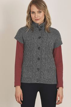 A short sleeved cardigan that works with everything from jeans to Seasalt printed dress's. Lambswool blend and patch pockets, it's cosy yet practical!