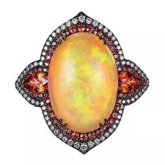 repost  from @thejewelcollective We still love this Alessio Boschi Fire Opal Ring. Jewellers are really using black rhodium well these days. It can turn a piece macabre, it can solidify a design, it can intensify the hues of the stones. It can make the same piece have two totally different moods, and we love  that about it! (Photo: polyvore.com) #thejewelcollective #alessioboschi #fireopal #blackdiamonds #roundbrilliant #ovalcut #cobochon #pearshape #dressribg #cocktailring #instarepost20