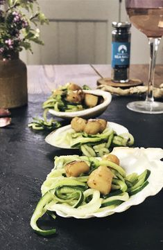 A sumptuous dish of pan seared scallops atop a bed of courgette 'spaghetti', with a simple white wine reduction and finished with Squid Ink Sea Salt.