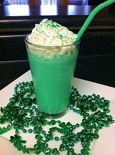 Skinny Shamrock Shake - Gotta try being healthier!   3/4 cup Milk  1/2 cup Breyers Double Churn Free Creamy Vanilla fat-free ice cream  1 Tbsp. Vanilla  1/4 tsp. peppermint extract  2 or 3 drops of green food coloring  1tsp sugar  1 1/2 cups crushed ice (8-12 ice cubes' worth)  Fat-free Reddi-wip