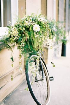 Vintage bicycle with wicker basket filled with flowers | Rise Hall in Yorkshire | English Country Garden Wedding | Illusion Back Annais Bridal 'Cecelia' Wedding Dress | Ashlee Taylor Barnes Photography | http://www.rockmywedding.co.uk/emma-james/