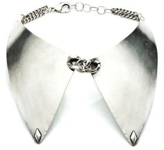 Since detachable collars are the rage these days, it might as well be silver.  Its like a dickey i guess.
