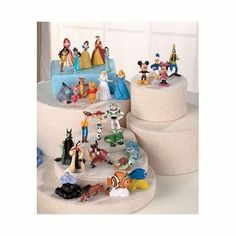 Disney Movie Character 29 Piece Figurine Set Princesses, princes and villains from movies like Snow White, Mulan, Sleeping Beauty, Beauty and the Beast, and more. Pocahontas, Ariel, Jasmine and others. Heros and villains from Toy Story, Finding Nemo, Peter Pan, and others. Classic Disney characters like Mickey Mouse, Minnie Mouse, Donald Duck, Pluto, Winnie the Pooh, Piglet, Tigger, and Eeyore. 2.5 to 3 inches tall; plastic. Ages 3 and up.
