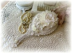 Shabby Chic Vintage Inspired Ornate Cream distressed Hand Mirror with Lace Rosette and Satin Roses ~ Shabby Cottage Chic Romantic chic