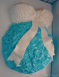 I just HAD to have the belly cake for my baby shower, it was actually decorated with delicious buttercream at a wonderful local bakery, so please keep in mind it CAN be done without it being covered in fondant