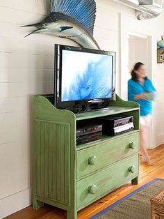 Great idea! Remove the top drawer on an old dresser and turn it into a media center!