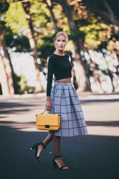Street Style, March 2015: The featured photo is of Janine is wearing a pleated mid skirt with a black long sleeved crop top from Topshop and black New Look heels