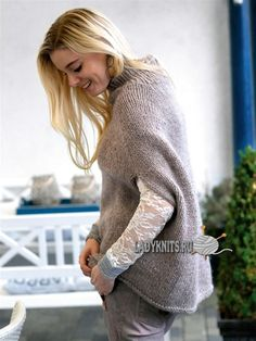 Вязаное спицами стильное пончо