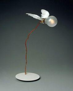 "Designed by Ingo Maurer ""Lucellino."""