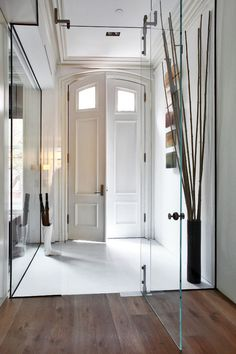 an elegant way to divide the hallway and break what could be a long, plain space (works for more narrow spaces?)