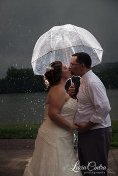 It was pouring on their wedding day, but it was the perfect opportunity for some amazing shots in the rain! I'm so glad they weren't afraid to get a little wet, this is one of my favorite photos from their day!  © Lucia Cintra Pittsburgh Wedding Photographer
