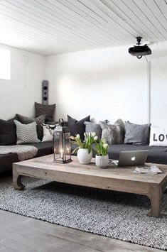 dark gray couch with lots of different pillows