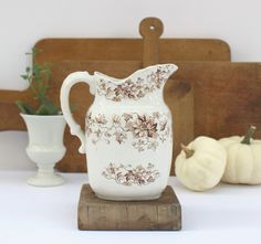 Ironstone Milk Pitcher Brown Transferware - Antique English Ironstone - JHW & Sons Hanley - c. 1900 - Edgevale - Semi Porcelain - Floral by SplendidJunkVintage on Etsy https://www.etsy.com/listing/475067600/ironstone-milk-pitcher-brown