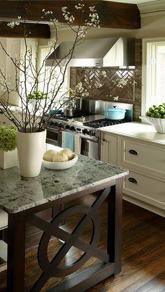 rustic dark wood beams + herringbone tile backsplash + white cabinets + island detail in kitchen design