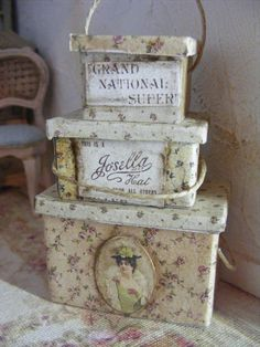 This is a set of three storage boxes each one opens,they have been covered in a vintage style paper.Each one has a woven handle,they have all