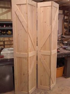 DIY barn door can be your best option when considering cheap materials for setting up a sliding barn door. DIY barn door requires a DIY barn door hardware and a Rustic Closet, Barn Door Closet, Diy Barn Door, Bi Fold Closet Doors, Ideas For Closet Doors, Sliding Closet Door Track, Hall Closet, Bifold Door Hardware, Bifold Barn Doors