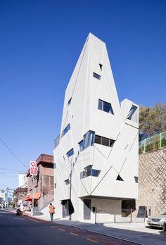 Moon Hoon's narrow Seoul house features small windows and diagonal markings