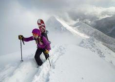 Liz Daley hiking in pow #snowboarding #splitboarding