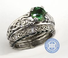 An amazing natural green sapphire in white gold custom Celtic ring, with hand carved swans.