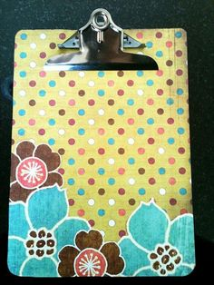 Learn how to create an adorable custom scrapbook clipboard in only 5 steps! Great to give as a gift or to organize those annoying little papers floating around your house. Includes photos, full instructions, a little humor, and links to purchase the supplies!