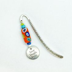 One of my uplifting bookmarks which Ive designed with bright colours and positive words. The carefully selected coloured glass beads and a Live Love Laugh charm compliment a Tibetan style marker. The bookmark measures approximately 9 cm and comes presented in an organza bag making it beautiful gift Book Lovers Gifts, Gift For Lover, My Bookmarks, Coloured Glass, Bright Colours, Positive Words, Live Love, Felt Christmas, Organza Bags