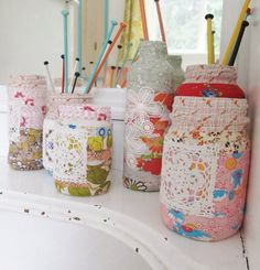 Cute little fabric wrapped jars. Love the little bits of lace, too. I need to do this with a few of my own! :)