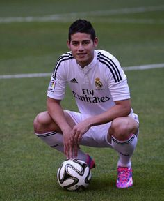 James Rodriguez signs for Real Madrid-----James Rodriguez poses with a ball  during his presentation on the pitch at the Santiago Bernabeu 60a241c22